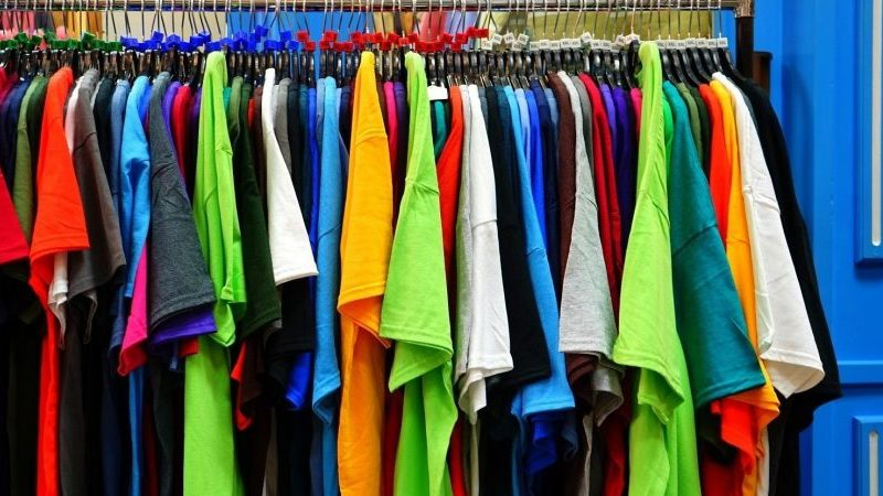 Colorful Shirts Hanging on Rack